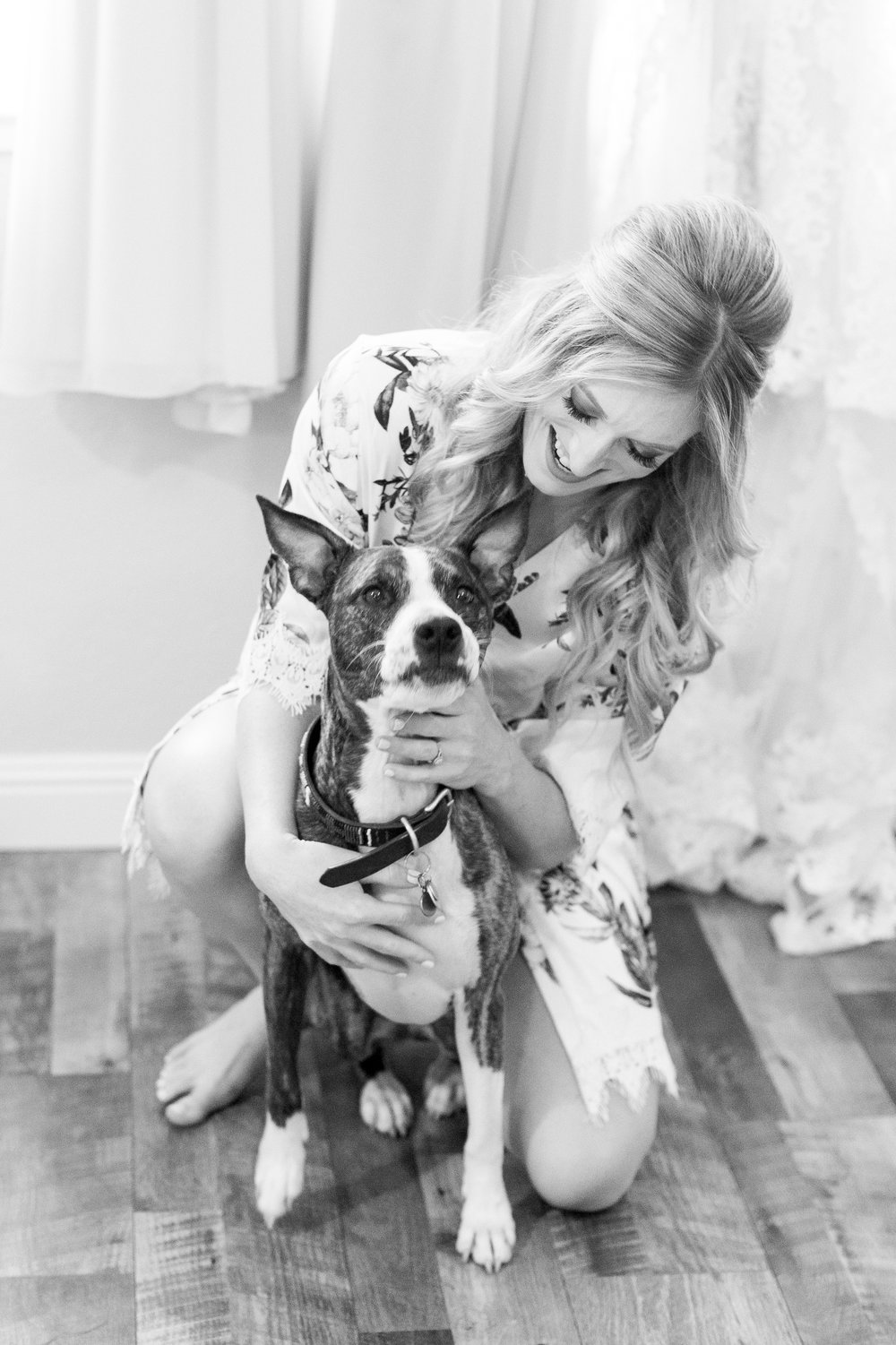 bride-holds-her-dog-on-her-wedding-day (33 of 274).jpg