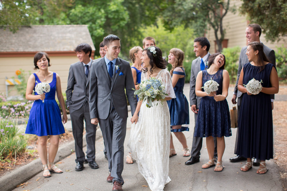 couple-walks-together-for-photos-on-wedding-day.jpg