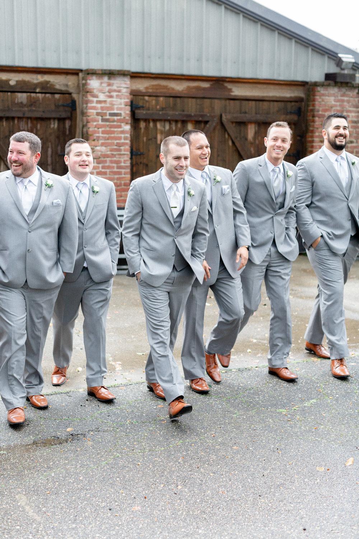 groomsmen-walking-photos-in-gray-suites.jpg