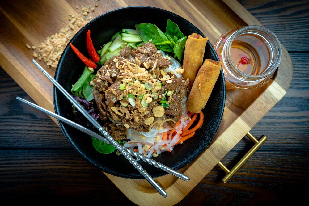 Noodles Salad - Teriyaki Steak + 2 Egg Rolls over Rice Vermicelli, Spring Mix, Cucumber, Pickles