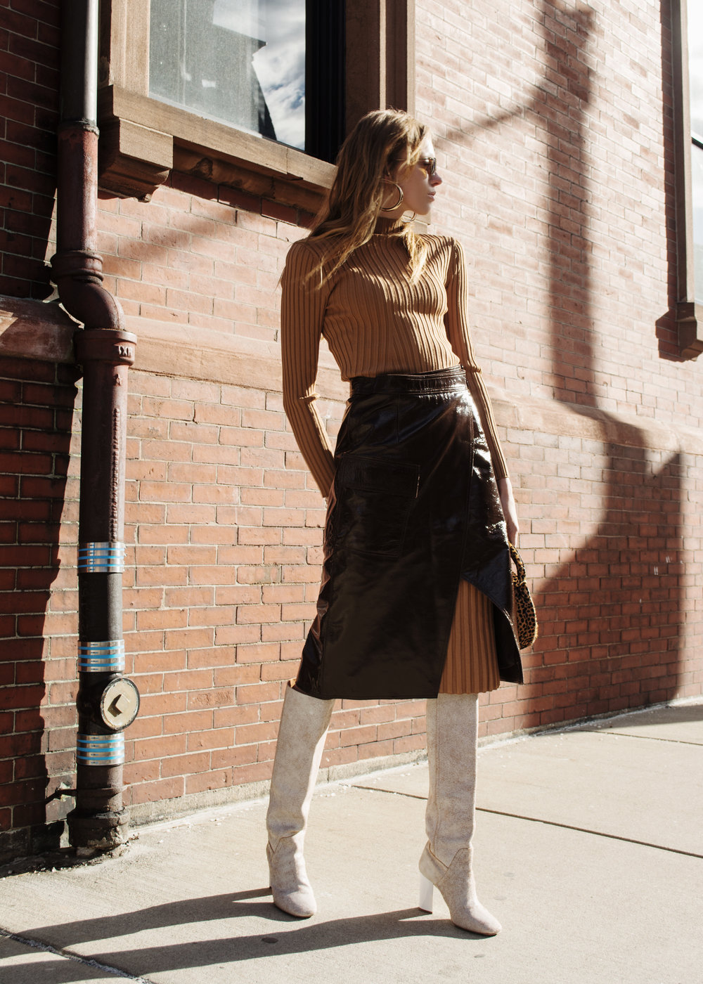 leather skirt is H&M, it's not online anymore but may still be in store. Here are a couple ofther options   Urban Outfitters Black Slit skirt   If you have a pretty penny to spend here's a  Brandon Maxwell version   And a more affordable version from  Boohoo