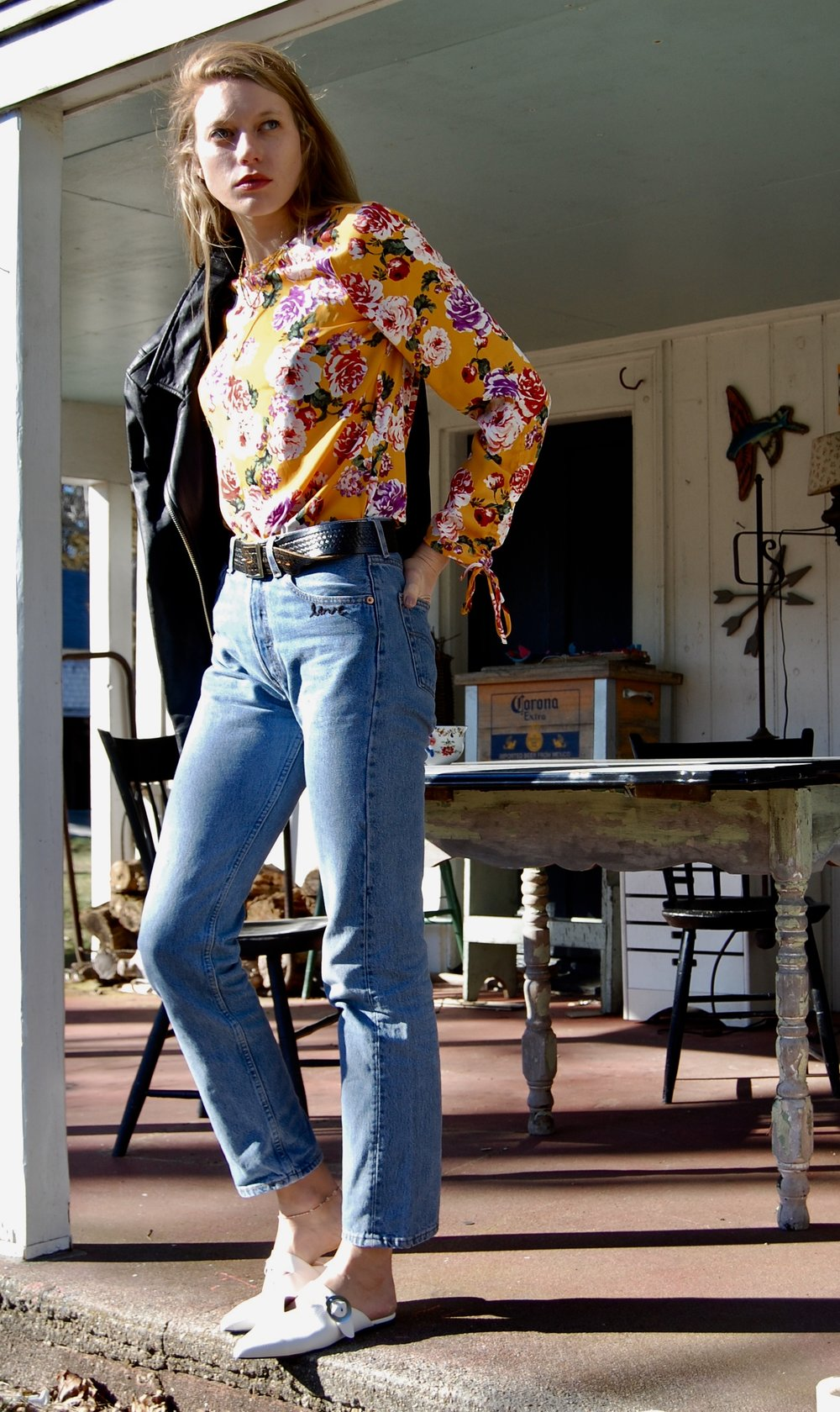 Shirt: Target . I seriously love this shirt. Any other mommas out there who don't have time to bring clothes to the dry cleaners? Me! So this shirt is nice because it still feels fashionable and nice but go ahead throw it in the washer.  Jeans: Vintage Levis! Found this at Garment district in Boston. Seriously can never go wrong with vintage levis.
