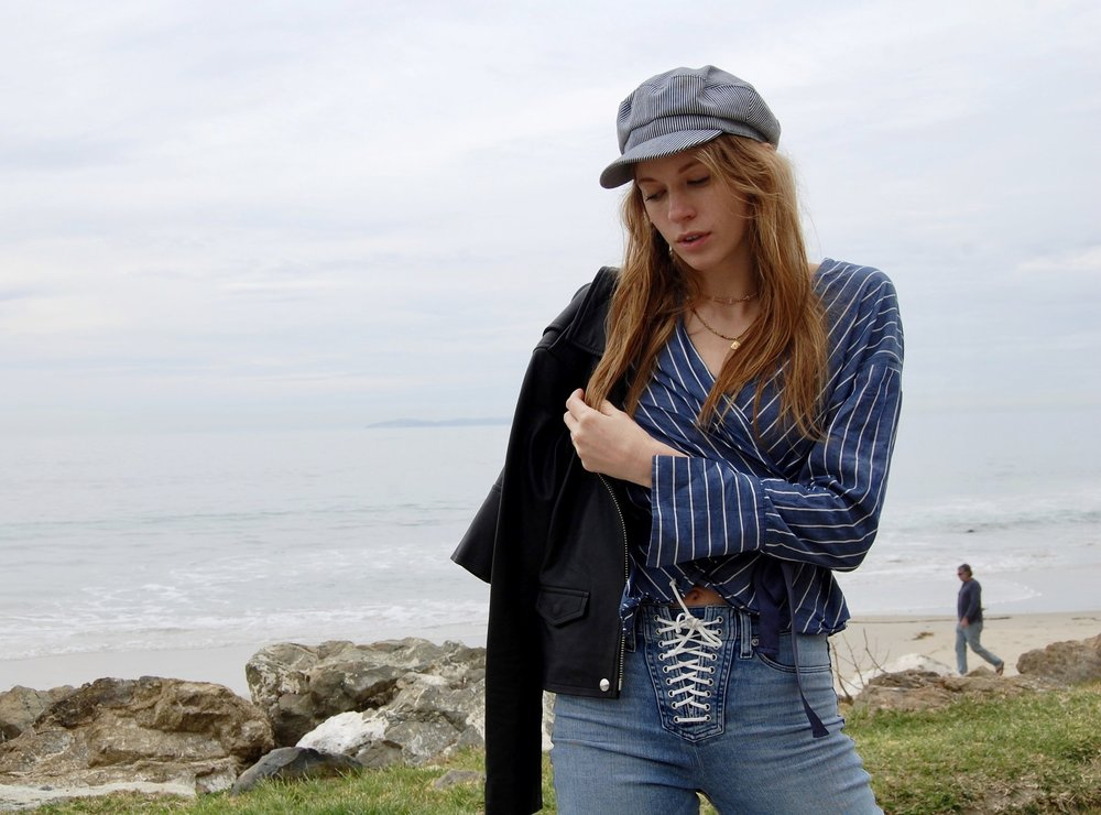 """Lets focus on the top now. You may have seen other bloggers posting about this top. It's kind of gangster. And I mean that in a """"it's super adorable and easy to throw on"""" kind of way. Its from the """"who what wear"""" x target collection.   Striped Wrap shirt    Hat: Zara . Im about as good with hats as I am at keeping my socks matching. With the packing, and traveling and squishing, I go through some hats. Zara has cute and affordable options if you suffer form hat responsibly probs as well.   The jacket , which I've posted before and will most likely continue to post, is IRO favorite leather ever.  Necklaces that I pretty much wear everyday  Mystic Rose"""