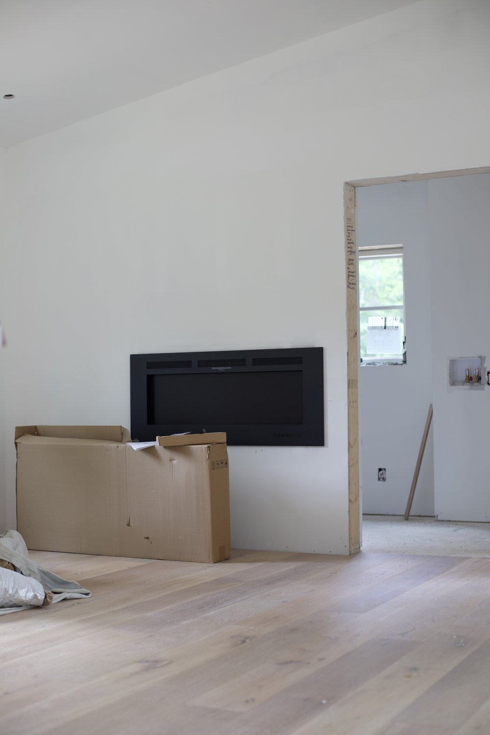 fire place &living room, with door way to laundry room.