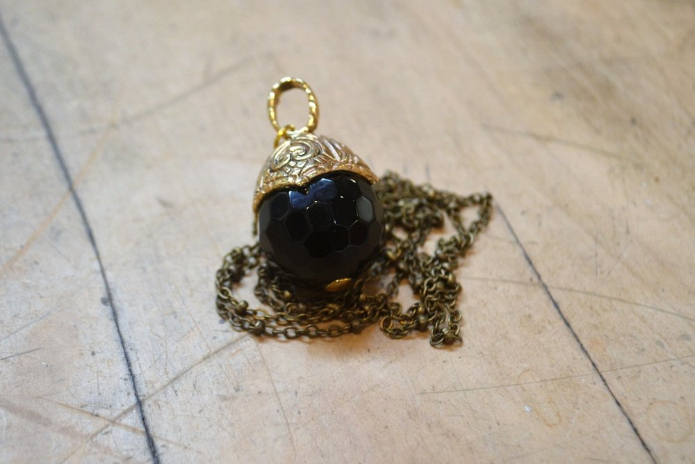 Onyx Acorn Heart Pendant  Old World Collection #22, brass and Onyx  $120.00