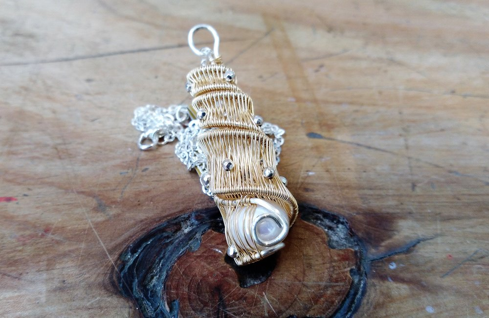 AC336  Gold spiral pendant in Gold plated artistic wire, with silver plated hematite beads and large focal Freshwater Pearl. Silver plated, nickel free chain and clasp.  $140.00