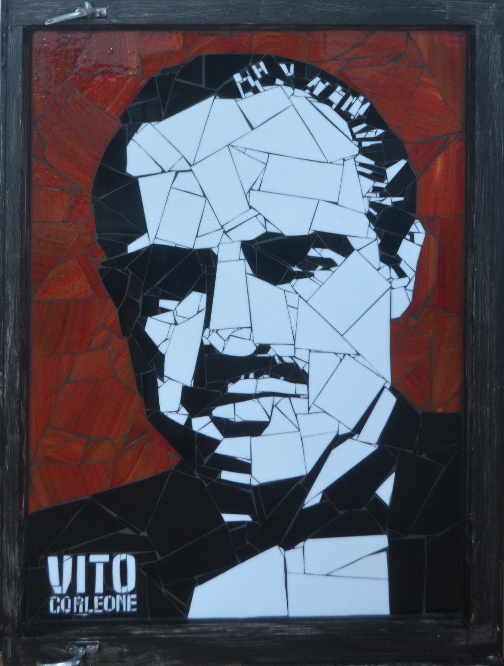 Vito Corleone  Danielle Fernandez, pop-art stained glass mosaic, sculpted on antique/distressed window pane, 910mm x 680mm. Vito Corleone was Marlon Brando's character in the classic movie The Godfather  $5,900.00