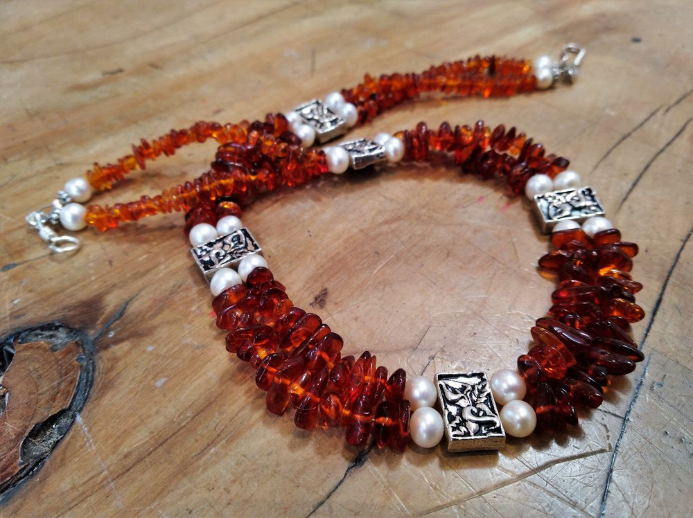 AC346  Baltic Amber with Freshwater Pearls and Tierra Cast Silver beads. Hand wired, nickel free clasp in silver plated artist wire. Tierra Cast: Lead and nickel free pewter with fine silver (99% pure) electroplating.  $300.00