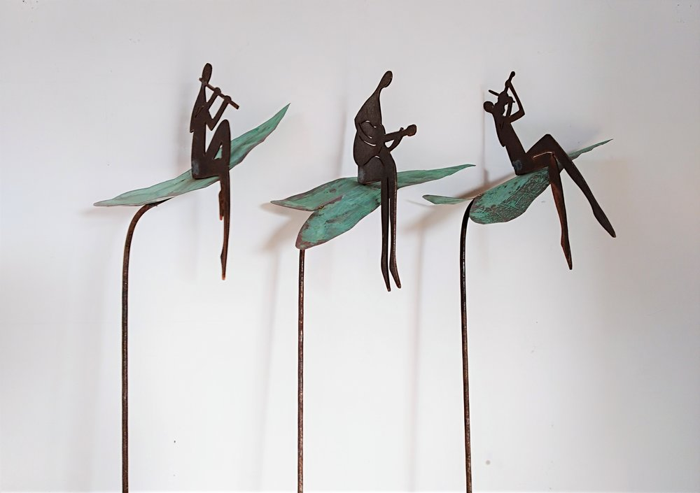 Musicians on Lillies  Mark Dimock, copper & steel garden sculpture (rod pushes into ground)  Flute Man - $245.00 Guitar Man - $245.00 Violin Man - $245.00