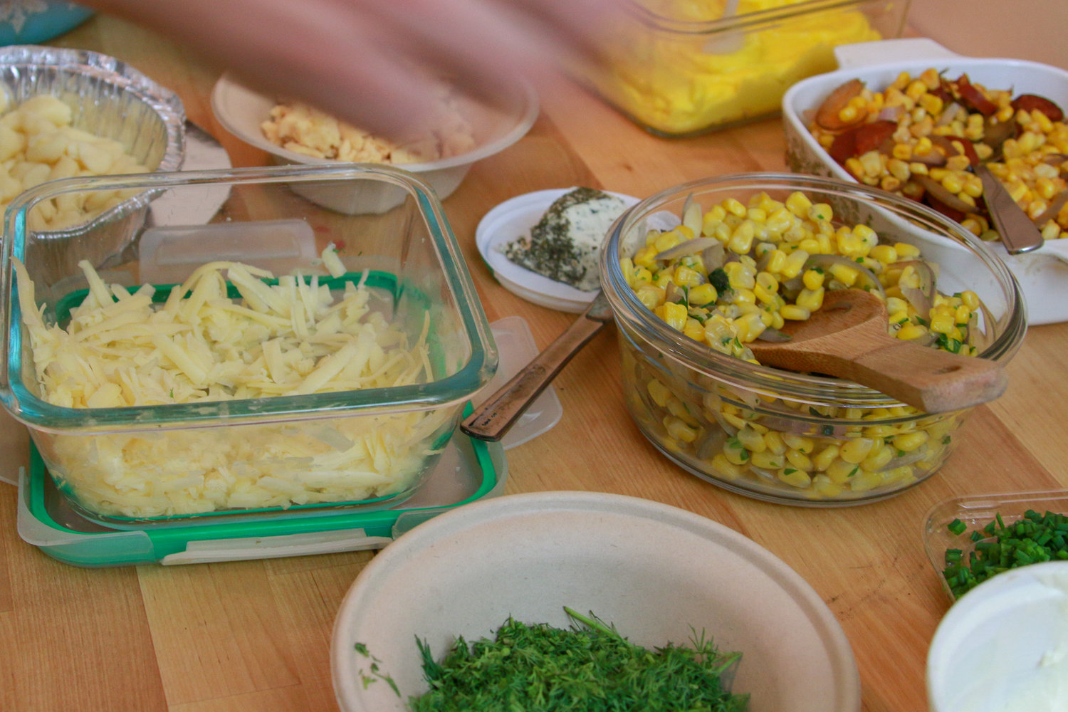 An array of toppings from a baked potato party