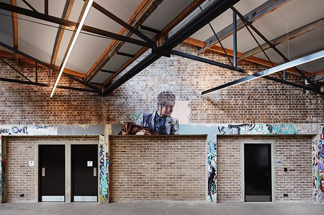 13 Bowden Street, Alexandria adaptive re-use — Photography: @floriangroehn — #sydneyarchitects#sydneyarchitecture#sydneydesign#commercialarcchitecture#warehouseconversion#adaptivereuse#australiaarchitecture#wproperty#archdaily#warehouse#streetart