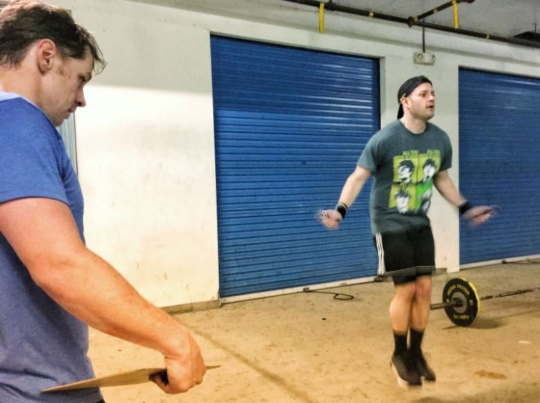 "After CrossFitting for nearly a decade and owning an affiliate for 8 or more years, you get to watch a lot of workouts.  On the count of 3, 2, 1, go!, I've watched thousands of people launch into the throws of three rounds for time. I've seen countless 20 minute AMRAP's, ascending and descending ladders, Murphs, 12 days of Christmas iterations, Open WODs, and other monstrous CrossFit Frankenstein workouts.  I've learned the general timelines of growth, tendencies of energy expenditure, and the nature of injury in regards to the prescription of adventure we dose to the common man.  In the last decade, the sport of CrossFit has radically changed, but when people are looking to make breakthroughs, I walk them over to the invisible pillars of CrossFit.  We walk right by the obvious pillars, the ones we already know about.  We nod respectfully at the Strict Pullup, Presses and the Dead Lift. We slow a little to pay homage to both of the Squats: the twin titans; and then we actually pause for one moment and stare at the beauty and power of the Clean and the Snatch.  But, we keep moving and I lead them back to exercises they know well, but maybe didn't know carried so much weight.  Here's the hack for your CrossFit.  Determine in your mind first, and then your daily practice, that you will master:  Burpees  Wall Balls  Double Unders  Toes to Bar  This is a way to level the ground in 80% of the WOD's you come across.  It can take a beginner who's got a lot of work to do in Strength and Oly Lifts, and let them run with the pack.  A veteran without these four pillars dug deep and set in concrete, will likely have lost ground at some competition or watched their position plummet on the CrossFit Open Leaderboard.     Burpees:   This is mental, and you must start with your mind.  Everyone hates burpees. You don't have to like them either, but you need to determine that you will be as good or better than most of the people you're standing next to.  If you do this, if you master this move, you will mentally be ahead of most people in the box even before you start the workout.  This is not a technique heavy movement.  It does not discriminate gender. Revolution.   Wallballs:   This is mental, and you must start with your mind.  Everyone hates Wallballs. You don't have to like them either, but you need to determine that you will be as good or better than most of the people you're standing next to.  If you do this, if you master this move, you will mentally be ahead of most people in the box even before you start the workout.  This move discriminates against the immobile, and short people, but if I can do this, you can do this.  Revolution.   Double-Unders (a.k.a. ""Anger Makers""):   This is mental, and you must start with your mind (You're getting the point right?).  Everyone hates Double-Unders. You don't have to like them either, but you need to determine that you will be as good or better than most of the people you're standing next to.  If you do this, if you master this move, you will mentally be ahead of most people in the box even before you start the workout.  This move does not discriminate gender, or strength, but your anger keeps you from practicing.  You've got to devote time with the rope. Stop watching YouTube videos, you don't need any more cues, and set a three minute clock to practice after every class.  Revolution.   Toes to Bar:   This is not all mental--you're not crazy--but it's still no excuse.  This move takes some strength and coordination to learn. If you have your kipping pull-up, then you should have your toes to bar—you just haven't put enough value on it.  You need more time on the bar, like when you couldn't stop trying for your kipping pullup because you wanted it so bad. And you know what's coming next...at some point you must determine that you will be as good or better than most of the people you're standing next to.  If you do this, if you master this move, you will mentally be ahead of most people in the box even before you start the workout.  Some of you reading this just need to dedicate regular time to these pillars.  Your strength is there and the coordination will come with repeated attempts and play. Others need a coach to cue you, film you, take you through hands on gymnastic patterns and identify efficiency issues--maybe even just tell you when to show up and what to do to get one of these.  Most people reading this will continue to avoid the vegetables I'm telling you to eat.  Test the idea though, I dare you. Keep an eye out and see how many people suffer when you are missing one or more of these pillars.  You can cover up for a while if you've only got one of these weaknesses. But, if two of these pillars show up in a WOD, you're in trouble. If you get triple whammied in one WOD, you're likely gonna find something to watch on Netflix instead hitting the 5:30 class.  Master these four moves and it will serve your whole CrossFit life. More play. More fun!"