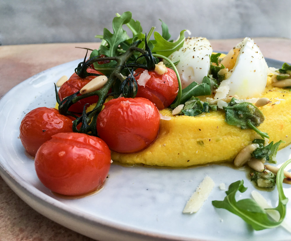 Polenta with melted tomatoes and egg