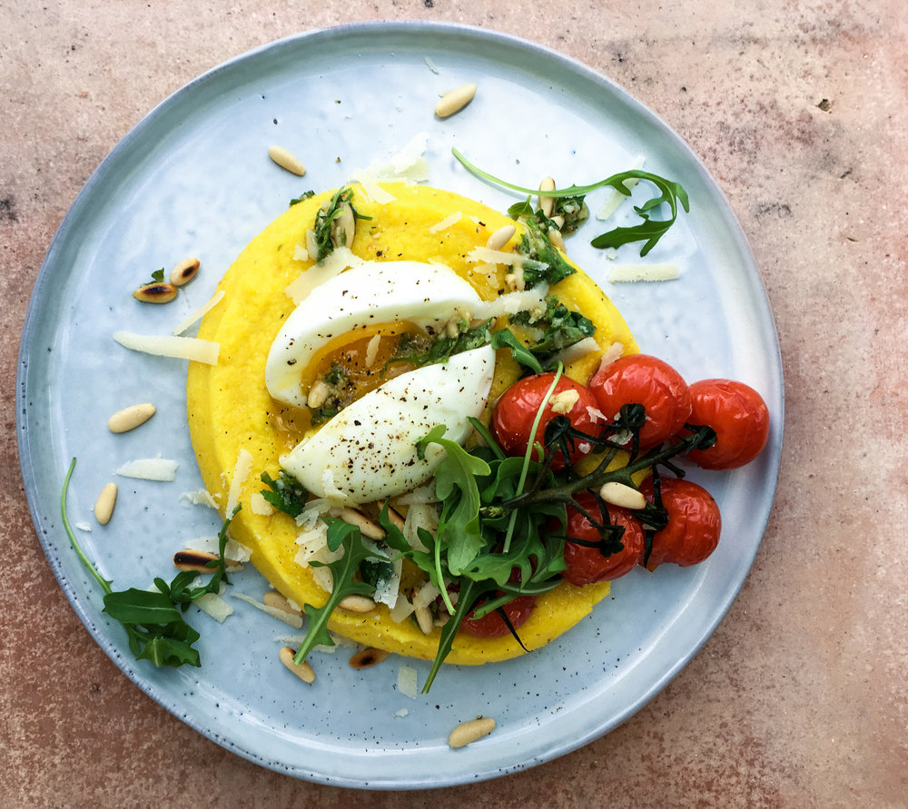 Creamy polenta with tomatoes and soft boiled egg