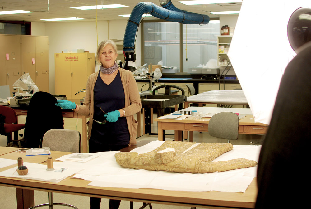 12/13/17 - Smithsonian Institution Museum Support Center, Suitland, MD: Textile conservator Julia Brennan explains the conservation process for the ceremonial gold robe.
