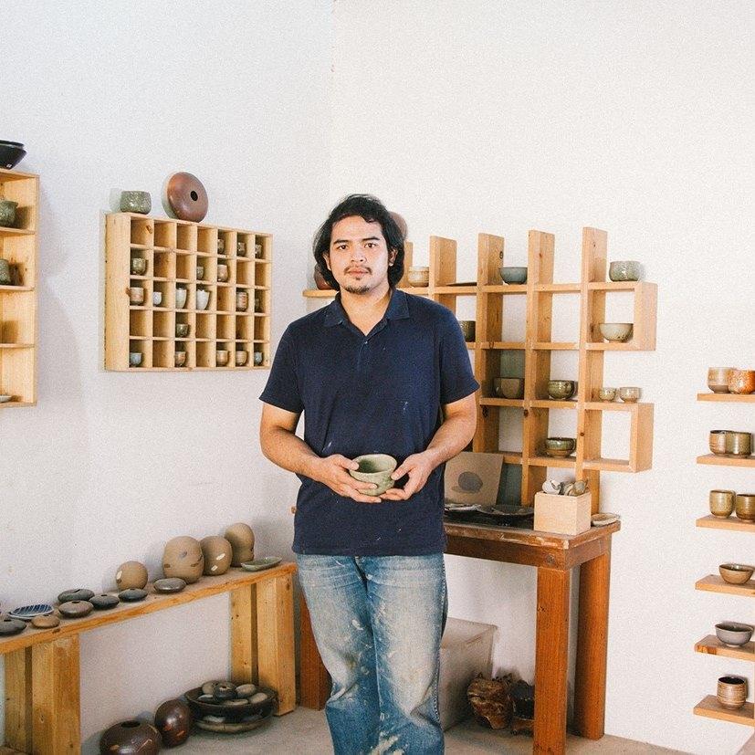 thai ceramist displaying his work.jpg