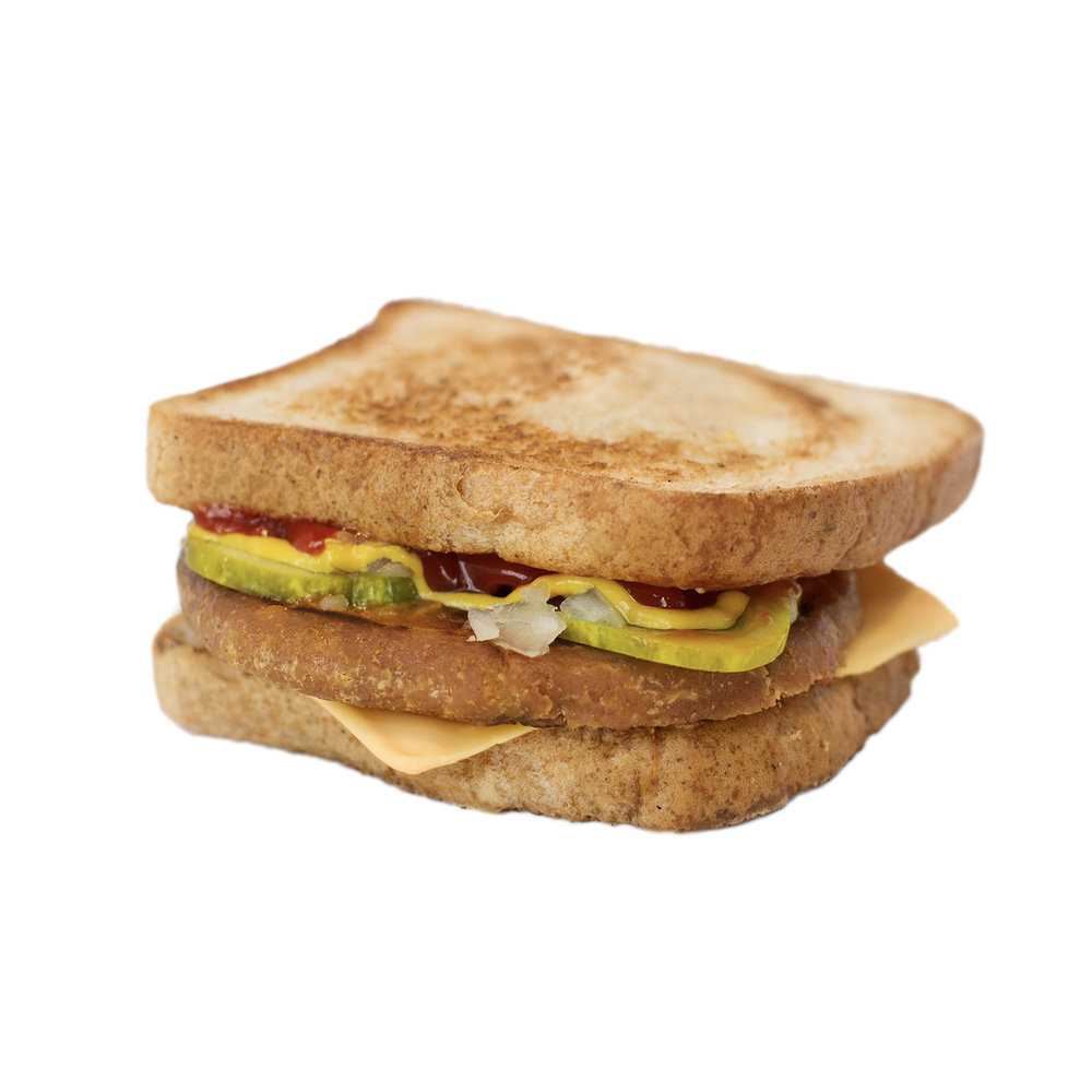 kids cheeze burger (GF) - Our delicious breakfast sandwiches include one hand cut tofu egg seasoned with black salt for an eggy flavour without any egg.  We pair it with a slice of American style cheddar cheese and serve it on a toasted white or whole wheat english muffin.   Add your choice of vegan ham, house made bacUN or vegan sausage!