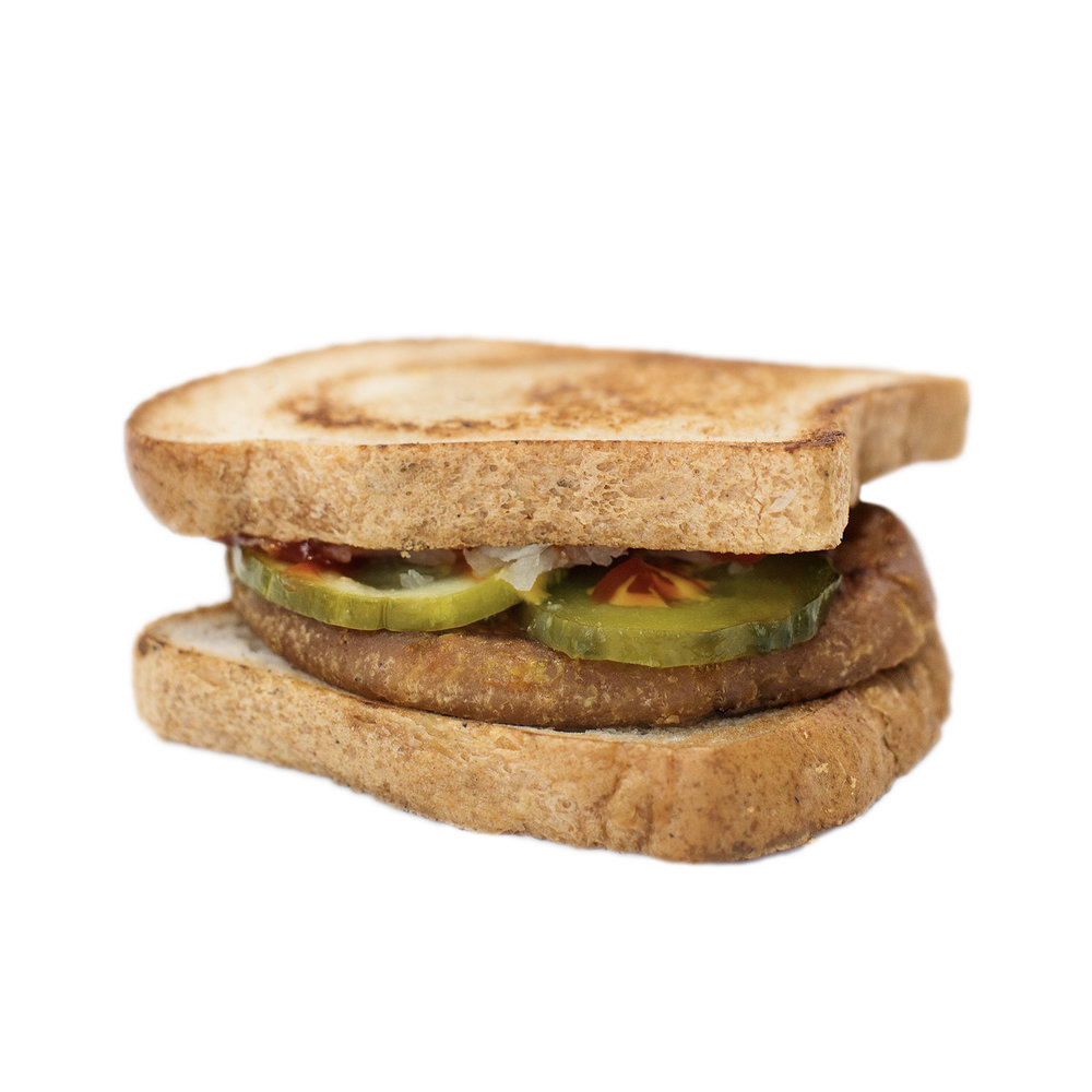 kids burger (GF) - Our delicious breakfast sandwiches include one hand cut tofu egg seasoned with black salt for an eggy flavour without any egg. We pair it with a slice of American style cheddar cheese and serve it on a toasted white or whole wheat english muffin.  Add your choice of vegan ham, house made bacUN or vegan sausage!