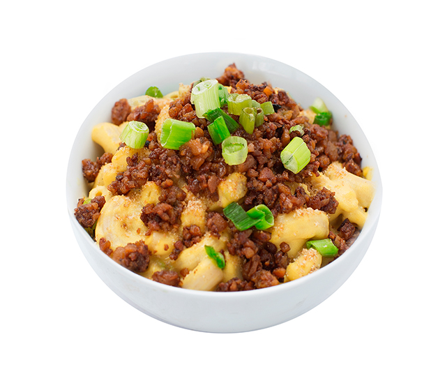 mac & cheeze with bacun  - Our creamy mac & cheeze topped with salty bacUn bits and fresh green onions.