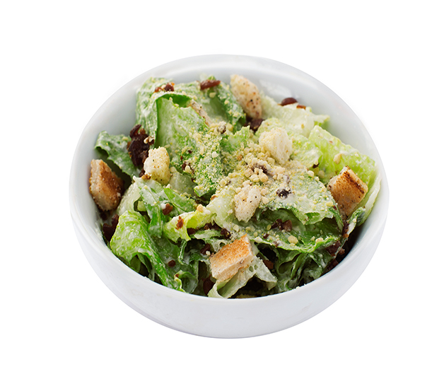 caesar salad - Crispy green leaf lettuce tossed with creamy caesar dressing, croutons, bacUn bits and parmesan cheeze!