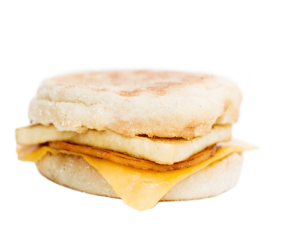 'ham' breakfast sandwich - Our 'ham' breakfast sandwich includes seasoned tofu 'egg' paired with a slice of 'ham' and dairy-free American style cheddar cheese, served on a toasted white or whole wheat English muffin.