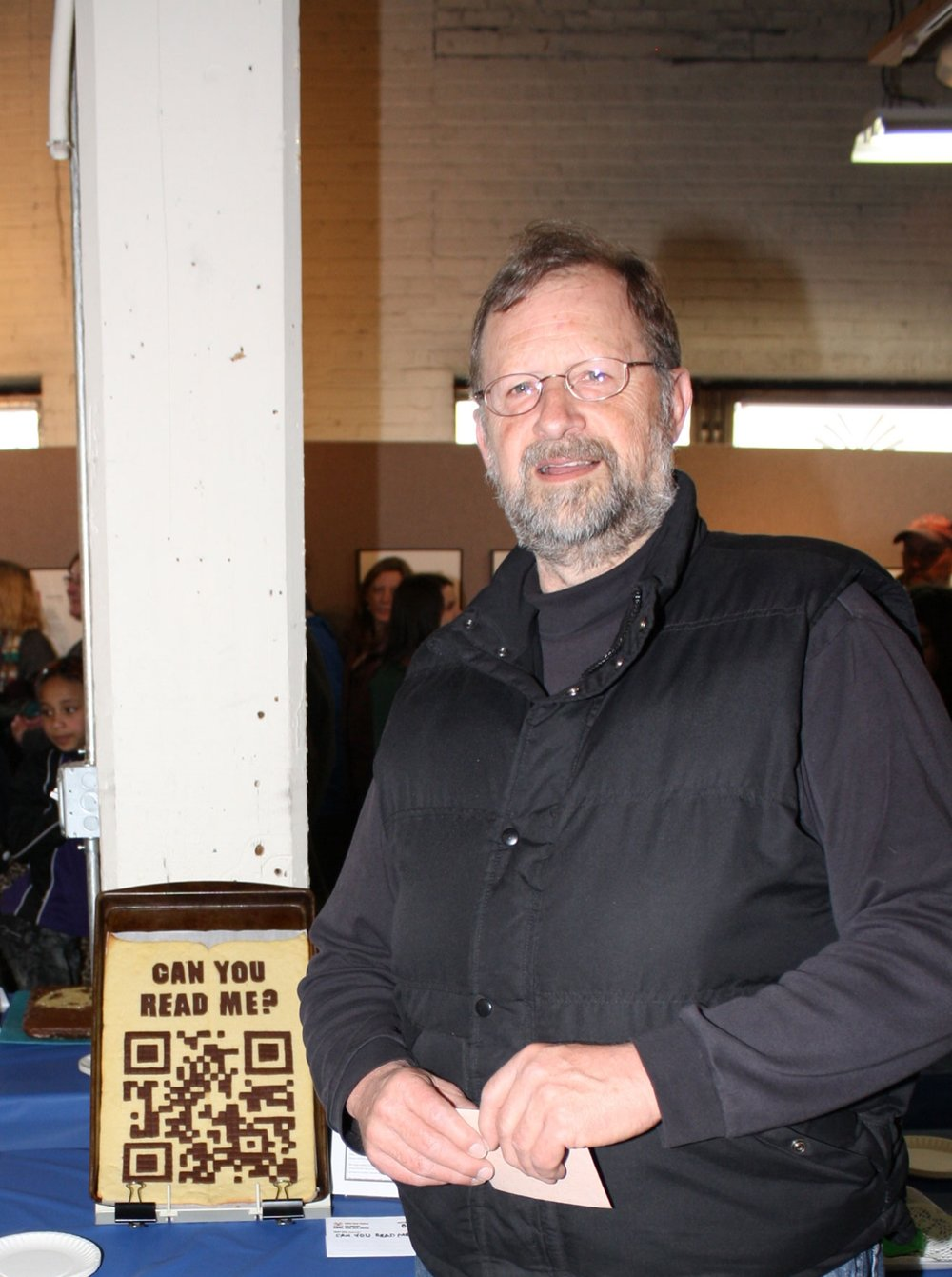 """Keith Jones, winner of Judge's Choice, with his book """"Can You Read Me,"""" featuring a QR code made of food that actually works!"""