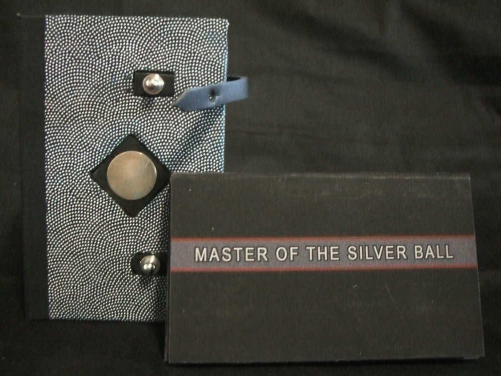 "Robert Hunter, ""Master of the Silver Ball,"" digital imaging-archivial Ink Jet print on Somerset paper book board, leather straps, Japenese decorative Paper, Silver Disk, 2013"