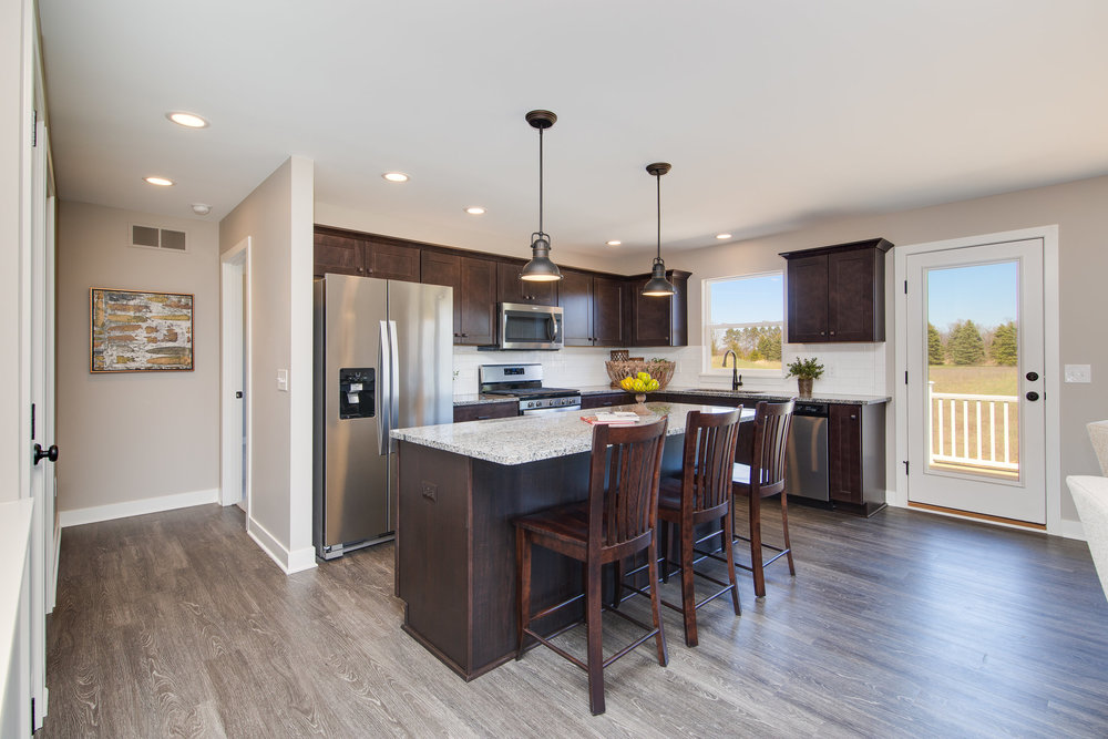 5+1+2018+AC-01-27-Aster_Kitchen_Stained+Cabinets_Granite_LVP[1].JPG