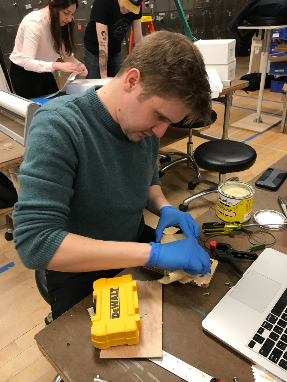 Brent applying wax to the case.
