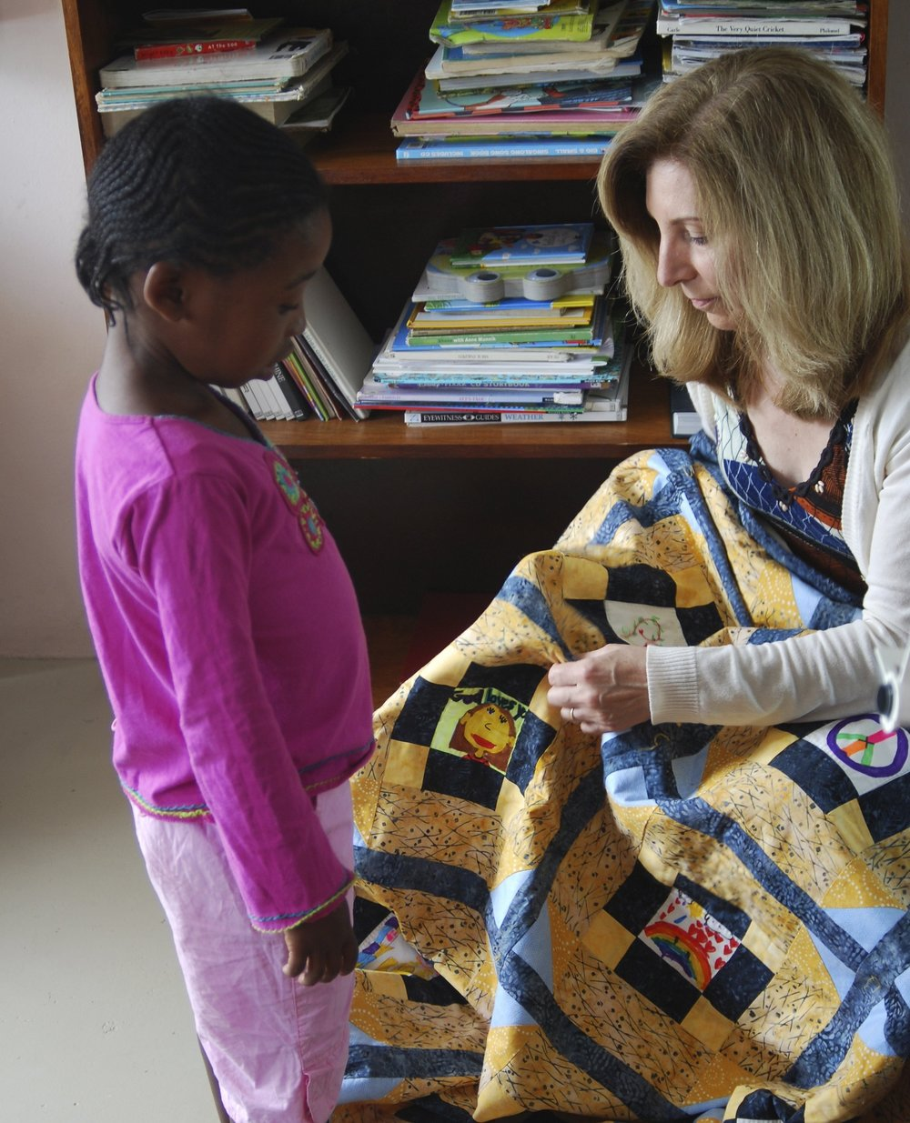 ABOUT US - The Love Quilt Project is changing the lives of vulnerable and orphaned South African children, many of them affected by the HIV / AIDS pandemic. We build relationships between American and South African children by funding education that teaches lessons on kindness, tolerance, and compassion to both groups.American children express what they have learned by drawing messages of love on small fabric squares that are stitched into quilts and distributed to children in South Africa's hardest hit communities. In return, the recipients also create art squares for quilts to be given to American children affected by HIV / AIDS. Love is the Common Thread will celebrate the thousands of children we have reached in both South Africa and the US, while raising the necessary funds to provide programs to more vulnerable children affected by the HIV / AIDS epidemic.