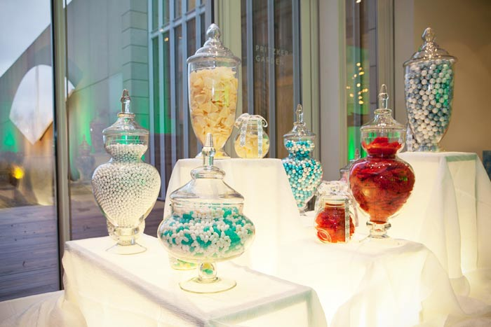 An illuminated table held jars filled with candy. Photo: Nancy Behall