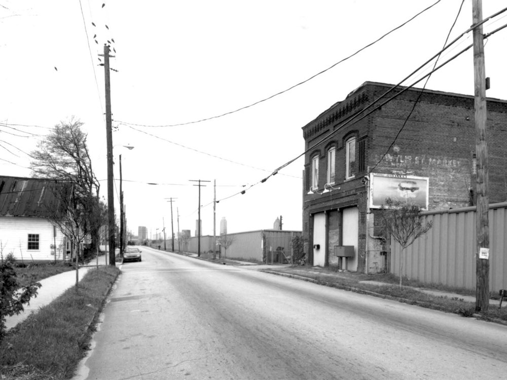 Isaiah P. Reynolds store on Wylie. The Sidewalk along the train yard is the current site of part of the Atlanta Beltline