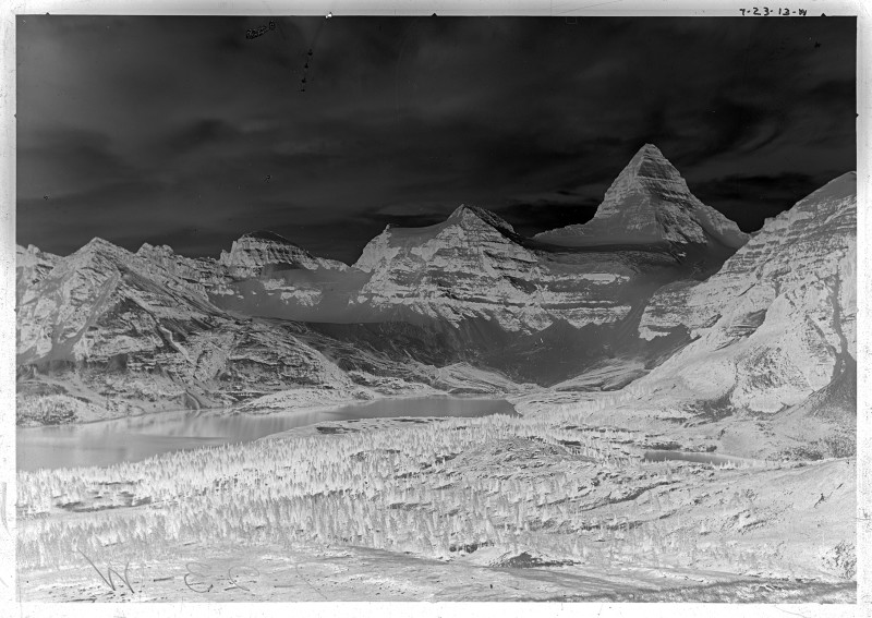 An example of a glass plate negative. This plate was taken in 1913 by A.O. Wheeler and crew as part of the Inter-Provincial Boundary Survey between Alberta and British Columbia. It was taken on a ridge below Nub Peak and looks over Magog Lake to the Mt. Assiniboine massif. Photo courtesy of Library and Archives Canada / Bibliothèque et Archives (LAC/BAC) Canada and the Mountain Legacy Project.
