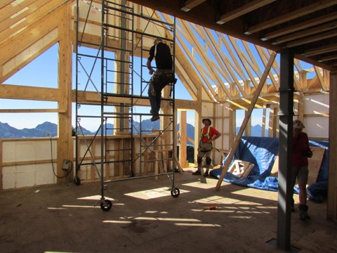 The main living area which will be heated by a high efficiency wood pellet stove. The two bunk rooms (sleep 6 each) are behind the photographer.