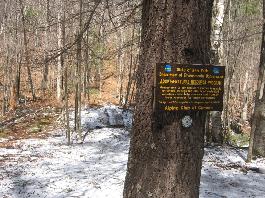 Trail sign representing our commitment to taking care of the property – Photo by Luc Massicotte.
