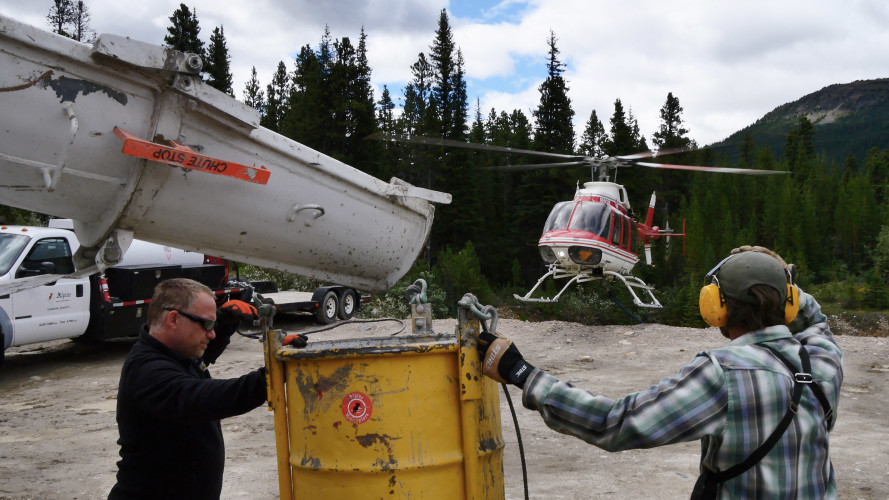 Crews pouring Lafarge cement into a hopper to be flown into the Louise and Richard Guy Hut. Photo by Will Schmidt.