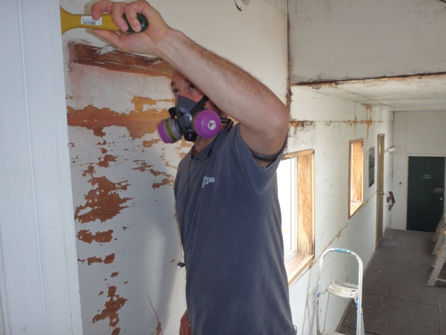 Scraping and painting the Bow Hut breezeway. Photo by Gavin Boutet.