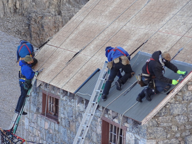 Roofing crew on the Alberta side of Abbot Pass Hut.