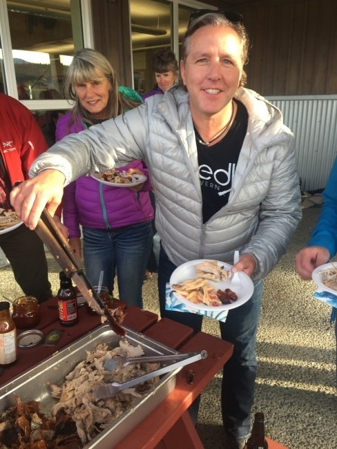 President of the ACC Neil Bosch dishing up some grub.