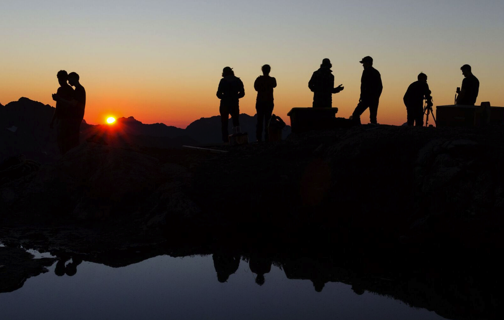 Volunteers and videographers at sunset. We had clear skies and great views for the final weekend of construction. Photo by Chris George.