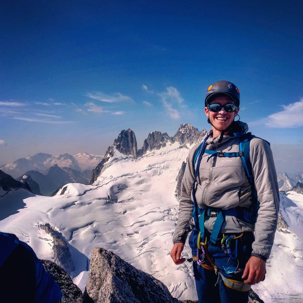 On the road to recovery, Connor on top of Bugaboo Spire.