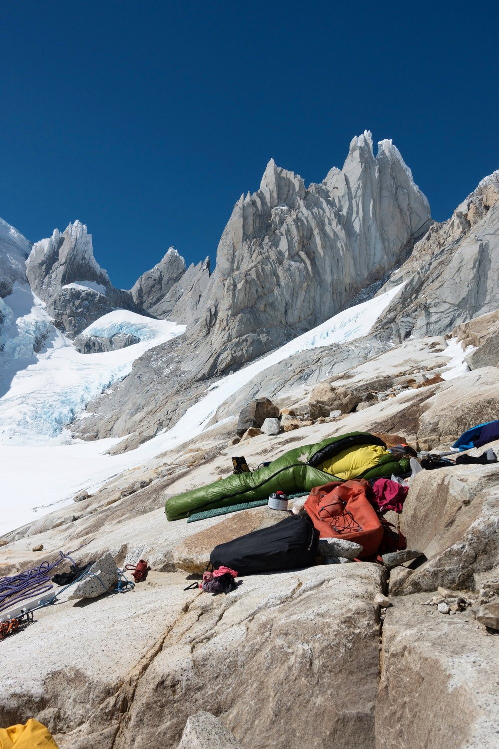 Resting in the sun after living in snow for two days! Letting the gear dry out and the temperature cool down before we continue up Cerro Torre West Face. Photo by Michelle Kadatz.
