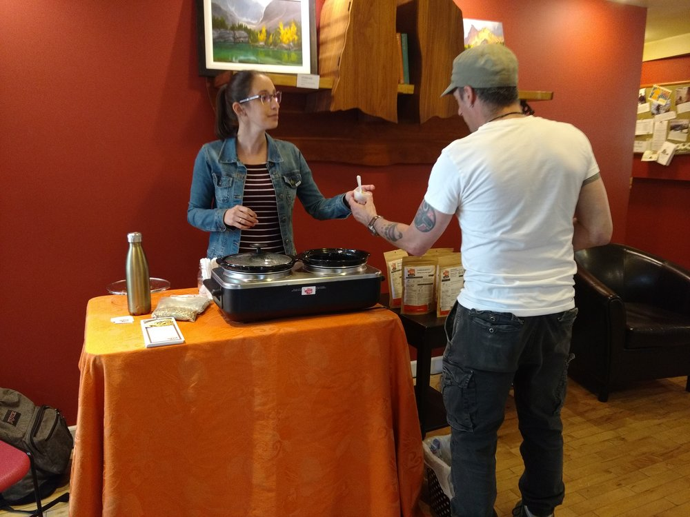 Melissa Beaulieu from Happy Yak hands out backcountry food samples in the lobby.