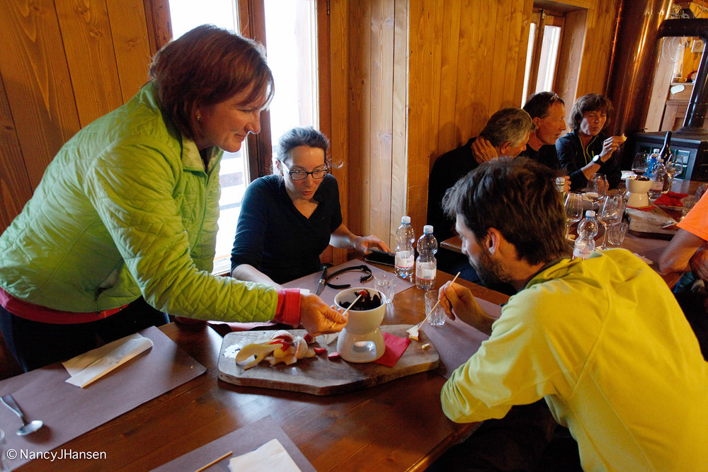 Enjoying chocolate fondue and fresh fruit at 3,647 m in Italy. Photo by Ralf Dujmovits.