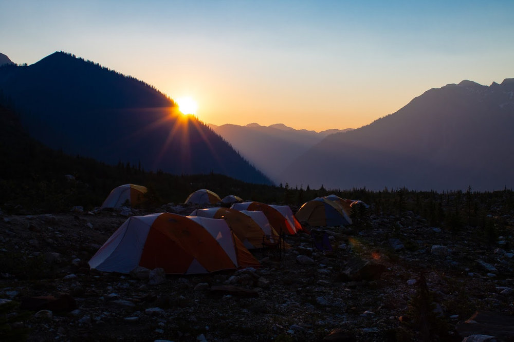 The morning sun is peaking around the mountainside as the Hallam General Mountaineering Camp wakes up for another day in these stunning mountains. We were all very snug and warm in our Mountain Hardwear tents for the week.  Photo: Natasha Salway