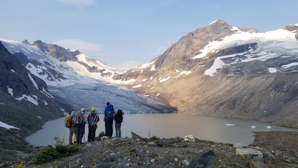 Participants of the leadership course are trying to determine the best way to navigate around Iceberg Lake.  Photo: Jess Scott.