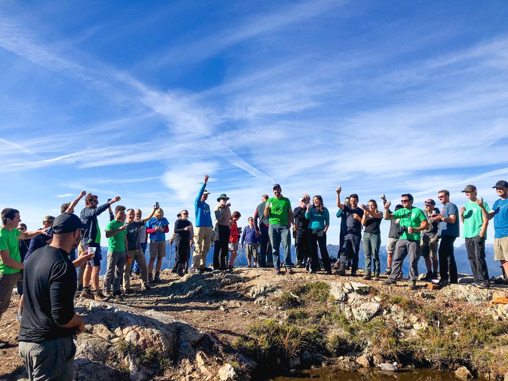 Volunteer team toasting their achievement.