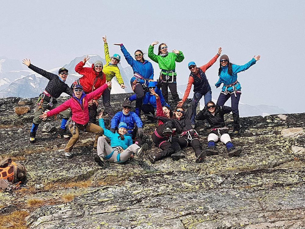 Back row (left to right):  Rosemarie Smith, Haylee Yellowbird, Cece Mortenson (mountain guide), Salimah Steffensen, Chloe Urbanowski, Allison Andrews (mountain guide), Alyana Lalani.   Middle row:  Ellie Bash (glaciologist), Olivia Smith, Yumna Sakkar, Leilu Munro, Kaya Oro Martin, Jordanna Young.  Centre front: Jocelyn Hirose.