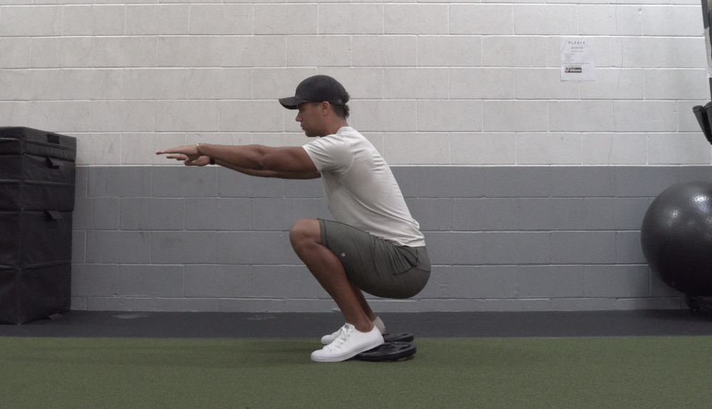 how to squat for beginners body weight bottom position