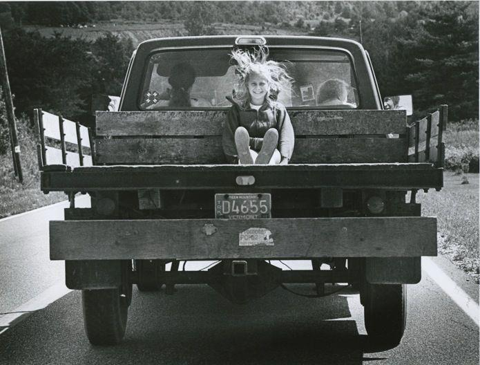 Girl in Back of Pickup Truck